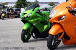 Slammed and stretched ZX-14 and Hayabusa with models in the background