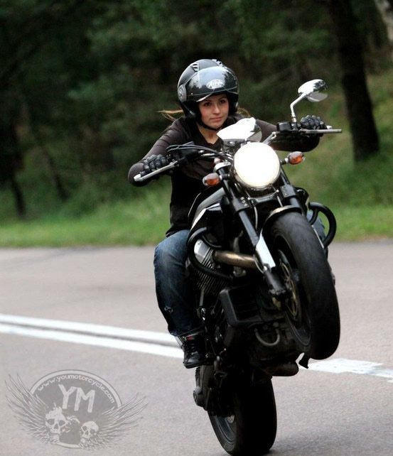 Woman Motorcycle Wheelie