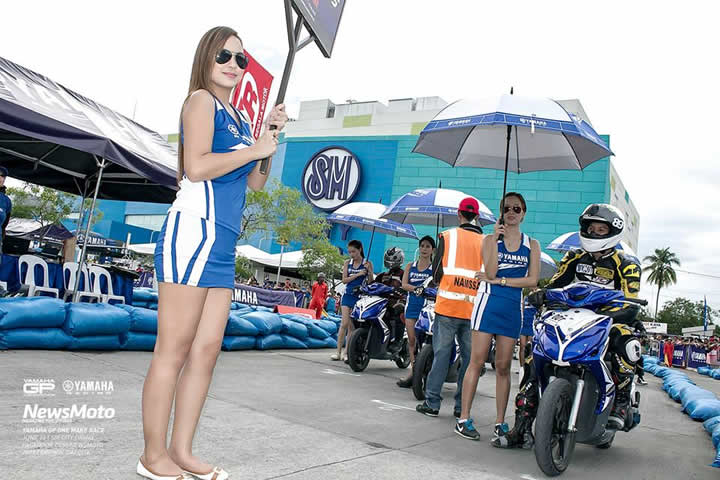 Motorcycle racing in the Philippines - sign girl
