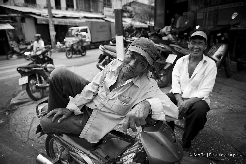 A Motorcycle Taxi rider in Chinatown Sai gon Viet Nam