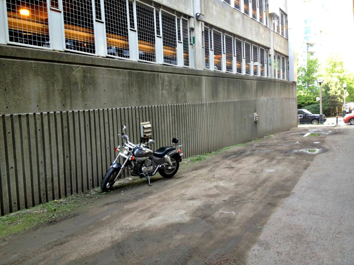 Downtown Toronto motorcycle parking behind a parking lot