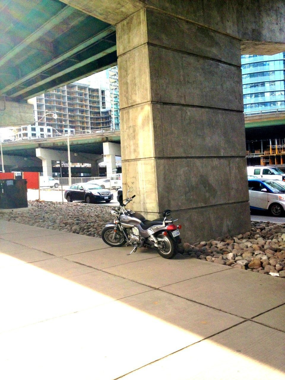 Downtown Toronto motorcyle parking under the Gardiner Expressway