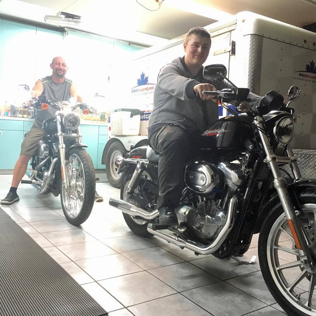 Father and Son on their matching Harley-Davidson Sportsters