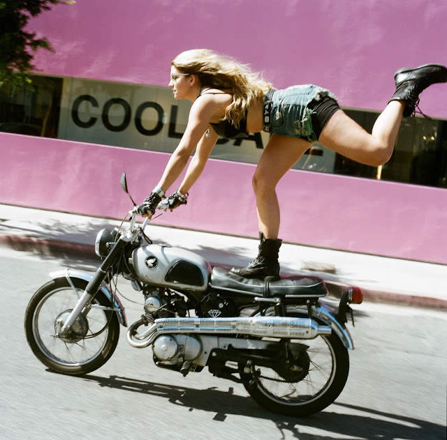 Girl Standing on Motorcycle - Is This Empowering