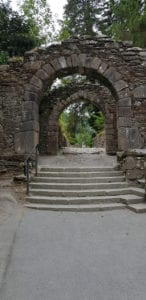 The entrance to the Glendalough monastery is decorated with a large cross carved into the side of the arch, bestowing a blessing on all travellers that pass through its gates.