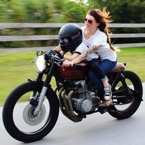 Mother and Son Riding a Honda Motorcycle