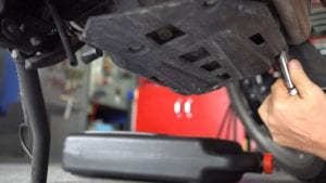 bmw f700gs oil change - step 1 - remove the sump protector