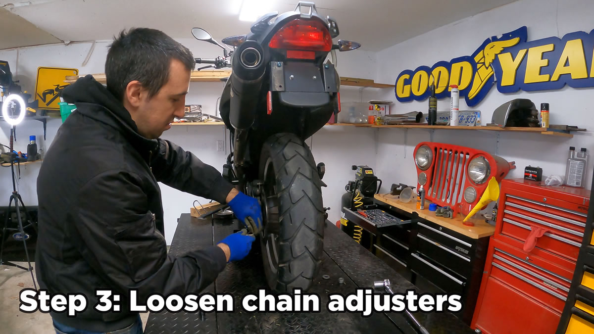how to remove rear motorcycle wheel - loosen chain adjusters